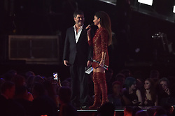 Simon Cowell and Nicole Scherzinger on stage at the BRIT Awards 2017, held at The O2 Arena, in London.<br /><br />Picture date Tuesday February 22, 2017. Picture credit should read Matt Crossick/ EMPICS Entertainment. Editorial Use Only - No Merchandise.
