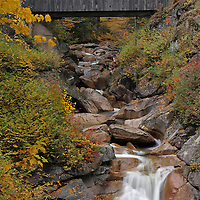Nature landscape photography images of this scenic autumn covered Sentinel Pine Bridge setting from the Franconia Notch State Park of the White Mountains in New Hampshire are available as museum quality photography prints, canvas prints, acrylic prints or metal prints. Prints may be framed and matted to the individual liking and decorating needs:<br /> <br /> http://juergen-roth.artistwebsites.com/featured/sentinel-pine-bridge-juergen-roth.html<br /> <br /> New England fall foliage peak colors at the Liberty Gorge at the Franconia Notch State Park near Lincoln, New Hampshire. The Sentinel Pine Bridge spans this beautiful New England gorge and a series of small waterfalls and cascades rush into The Pool. The pool is a deep basin in the Pemigewasset River and was formed at the end of the ice age.<br /> <br /> Good light and happy photo making! <br /> <br /> Juergen <br /> Prints: www.RothGalleries.com <br /> Licensing: www.ExploringTheLight.com <br /> Photo Blog: http://whereintheworldisjuergen.blogspot.com <br /> @NatureFineArt