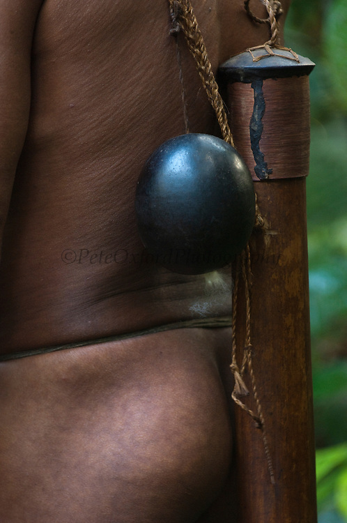 Huaorani Indian blow gun dart holder. Gabaro Community. Yasuni National Park.<br /> Amazon rainforest, ECUADOR.  South America<br /> They still hunt with blow guns and darts that are loaded with Curari poison.<br /> This Indian tribe were basically uncontacted until 1956 when missionaries from the Summer Institute of Linguistics made contact with them. However there are still some groups from the tribe that remain uncontacted.  They are known as the Tagaeri. Traditionally these Indians were very hostile and killed many people who tried to enter into their territory. Their territory is in the Yasuni National Park which is now also being exploited for oil.