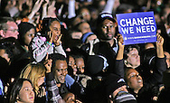Barak Obama supporters cheer at a rally in Manassas, Virginia on the last night of the campaign--November 3rd, 2008.  Crowd estimate 90,000.  Photograph by Dennis Brack