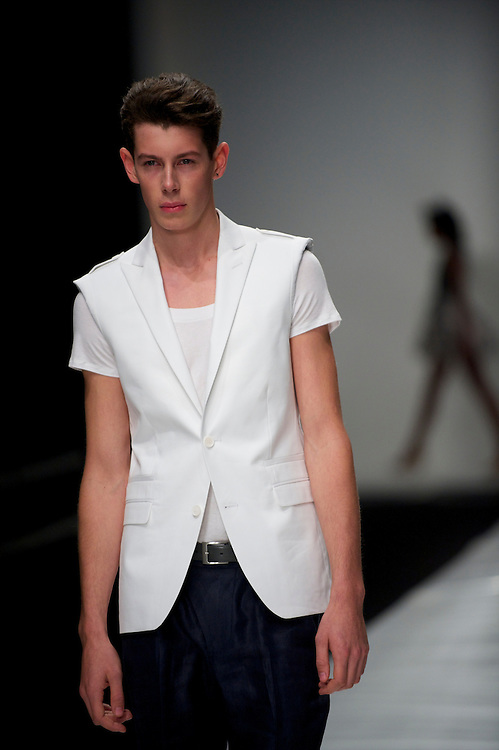 Models exhibit the Paul Costelloe spring 2011 collection down the catwalk at Somerset House in London on 17 September 2010.
