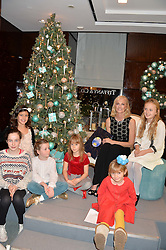 JOELY RICHARDSON and children at a VIP evening hosted by Joely Richardson at the Tiffany & Co Christmas Shop, Tiffany & Co Old Bond Street, London on 24th November 2013.