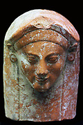 Terracotta protome in the form of a woman's head. From a tomb in the Fikellura cemetery of Kamiros, Rhodes Made in East Greece, about 500-450 BC