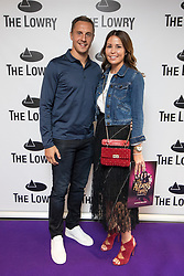 © Licensed to London News Pictures . 30/08/2017 . Salford , UK . Everton footballer Phil Jagielka and his wife Emily . Purple carpet photos of celebrities, actors and invited guests arriving for the press night of the musical comedy , Addams Family , at the Lowry Theatre . Photo credit : Joel Goodman/LNP