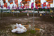 Infatable swan dying in the West Holt area where heavy rain created a mud bath during the Glastonbury Festival 2016, United Kingdom. Glastonbury Festival is the largest greenfield festival in the world, and is now attended by around 175,000 people. Its a five-day music festival that takes place near Pilton, Somerset. In addition to contemporary music, the festival hosts dance, comedy, theatre, circus, cabaret, and other arts. Held at Worthy Farm in Pilton, leading pop and rock artists have headlined, alongside thousands of others appearing on smaller stages and performance areas.