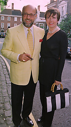 MR & MRS PETER DE SAVARY, at a party in London on 25th June 1998.MIT 143
