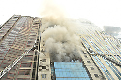 March 28, 2019  - Dhaka, Bangladesh - Firefighters try to douse flame after a fire broke out at a high-rise building in Dhaka, Bangladesh. At least one person has died and 30 others rushed to hospital as a massive fire engulfed a high-rise building in Bangladesh capital Dhaka's upmarket Banani Thursday afternoon, a hospital official said. (Credit Image: © Salim Reza/Xinhua via ZUMA Wire)