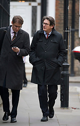 © London News Pictures. 16/11/2011. London, UK. Editor of The Guardian Newspaper Alan Rusbridger (right) arriving at The Royal Courts Of Justice this morning (16/11/2011) to give evidence at the Leveson Inquiry into press standards. Photo credit: Ben Cawthra/LNP