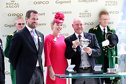 Peter Phillips (left) and Autumn Phillips (centre) present owner Steve Parkin (right) with a trophy after Soldier's Call wins the Windsor Castle Stakes during day five of Royal Ascot at Ascot Racecourse.