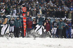 Philadelphia Eagles quarterback Nick Foles #9 carries the ball during the NFL game between the Detroit Lions and the Philadelphia Eagles on Sunday, December 8th 2013 in Philadelphia. The Eagles won 34-20. (Photo by Brian Garfinkel)