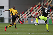 Frank Nouble of Newport County is challenged by Greg Taylor of Cambridge Utd (r).The Emirates FA Cup, 2nd round match, Newport County v Cambridge United at Rodney Parade in Newport, South Wales on Sunday 3rd December 2017.<br /> pic by Andrew Orchard,  Andrew Orchard sports photography.