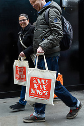 © Licensed to London News Pictures. 13/04/2019. LONDON, UK. Happy shoppers after visiting Sounds of the Universe records shop. Analogue music fans visit independent record shops in Soho to celebrate vinyl music on the 12th Record Store Day.  Over 200 independent record shops across the UK come together annually to celebrate the unique culture of analogue music with special vinyl releases made exclusively for the day.  In 2018, sales of vinyl rose for the 11th consecutive year to 4.2 million units according to the British Phonographic Industry (BPI).  Photo credit: Stephen Chung/LNP
