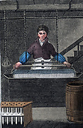 'The Tallow Chandler produced candles from suet or fat.  Here a frame of candles is being dipped into a bath of liquid fat.  Hand-coloured woodcut from ''The Book of English Trades'', London, 1823.'