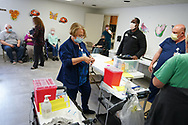 Registered nurse Elizabeth Brewer prepares supplies as Lehigh Valley Health Network brought their mobile vaccination clinic to Majestic House on May 6, 2021, which offers low income housing to Seniors 55 years and over, in Tamaqua, Pennsylvania.