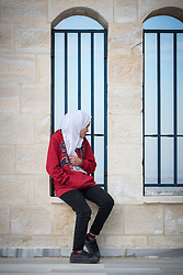 16 February 2020, Irbid, Jordan: A girl sits by a window at the Islamic Centre in Al-Mazar after participating in a psychosocial support session for Syrian refugees and Jordanian host community families, organized by the Lutheran World Federation.