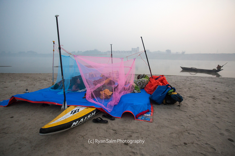A local fisherman takes notice of the crazy foreign housing compound on the banks of the Ganga.