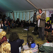 Plenary at the Main Marquee; Climate Justice:Copenhagen and beyond. Panel with Clayton Thomas Muller  from <br /> Indigenous Environmental Network in Canada, Joanna Cabello from Carbon Trade Warch, Friends of the Earth and Chris Kitchen from Climate Camp. A huge crowd filled the main marquee, listening and asking questions regarding COP15.<br /> <br /> Clayton Thomas Muller from Canada sings the Turtle Song about finding your inner strength to make good things happen.