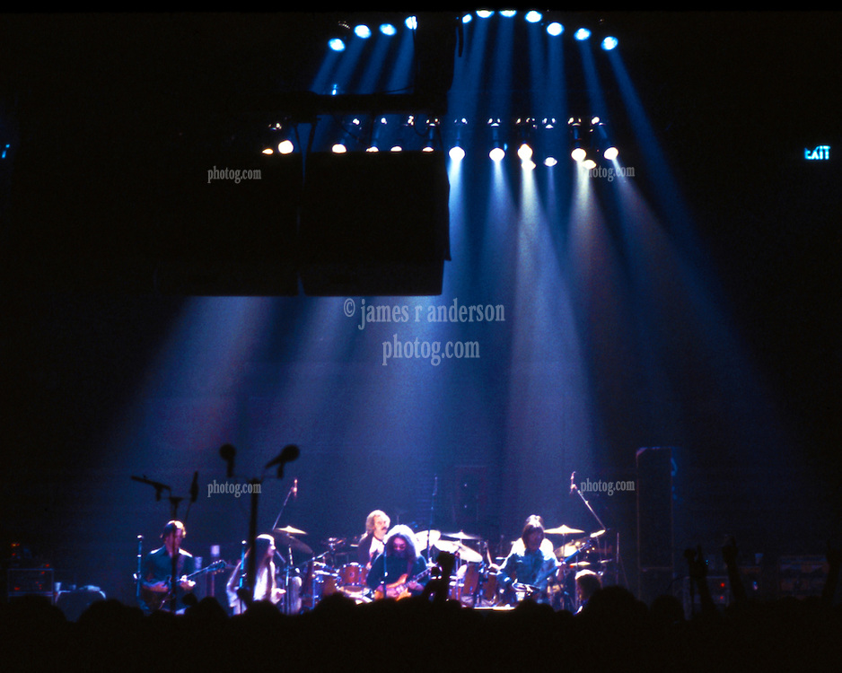 Grateful Dead Concert New Haven Coliseum 17 January 1979. Stage full straight on view capturing lighting design, band and PA. Also included, no extra charge, my AKG D200E microphones with the foam windscreens, left of center.
