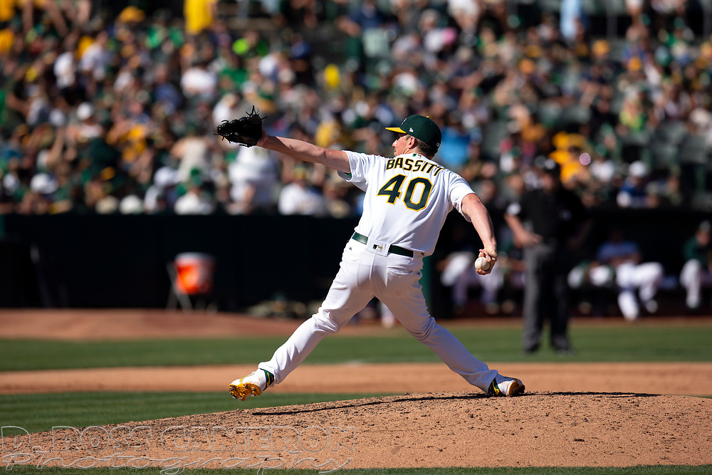 Oakland Athletics pitcher Chris Bassitt (40) delivers against the Texas Rangers during the sixth inning of a baseball game, Sunday, Sept. 22, 2019, in Oakland, Calif. (AP Photo/D. Ross Cameron)