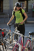 A lady cyclists prepares to ride through Slovenska Cesta (Street) in the Slovenian capital, Ljubljana, on 26th June 2018, in Ljubljana, Slovenia. Ljubljana is a small city with flat terrain and a good cycling infrastructure. It was featured at eighth on the 'Copenhagenize' index listing the most bike-friendly cities in the world.