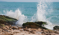 View of splashing waves near beach at atlantic ocean