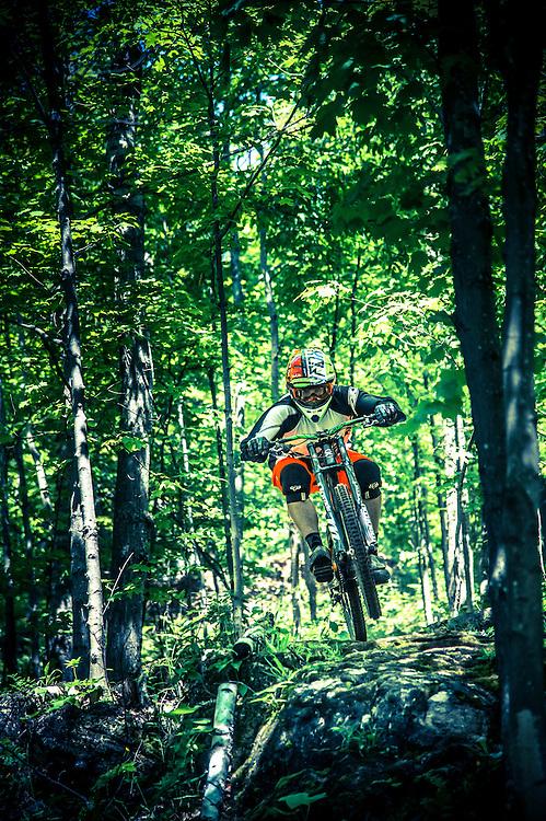 Downhill mountain biking on the Benson Grade freeride area of the Noquemanon Trails Network's South Trails area of Marquette, Michigan.