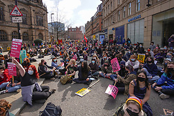 © Licensed to London News Pictures. 3/04/2021. Sheffield, UK. Demonstrators sit in the street outside Town Hall during a 'Kill The Bill' protest against the Government's Police, Crime, Sentencing and Courts Bill, in Sheffield. The proposed Police, Crime, Sentencing and Courts Bill would give police in England and Wales more power to impose conditions on non-violent protests. Photo credit:  Ioannis Alexopoulos/LNP