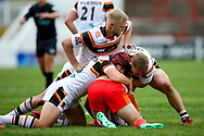 Bradford Bulls loose forward Damian Sironen (10), Bradford Bulls replacement Reiss Butterworth (33) and Bradford Bulls hooker Sam Hallas (29) all in the tackle during the Kingstone Press Championship match between Sheffield Eagles and Bradford Bulls at, The Beaumont Legal Stadium, Wakefield, United Kingdom on 3 September 2017. Photo by Simon Davies.