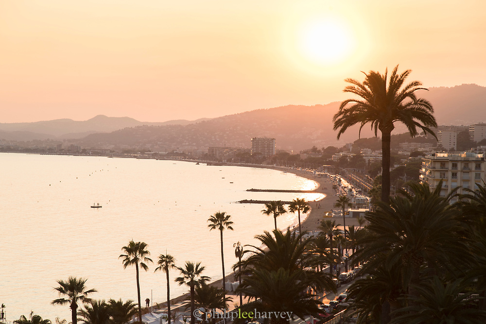 High angle view on Cannes city over shore at sunset, Cannes, France