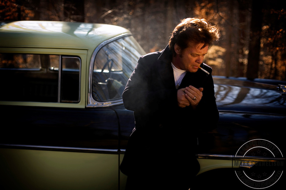 """John Mellencamp with his 1956 Chevrolet Nomad in Bloomington Indiana just before the release of his new album """" Freedom'.s Road""""  on Friday January 19,2007. ©Mark Cornelison"""