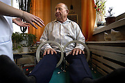 Marc Piscotty/News Staff Photographer<br />SHOT 11/13/2002 - Nasibullah Khudiatullin sits with his swollen knuckles and knees surrounded by magnets during a physical therapy session at the Urals Center for Radiation Medicine in Chelyabinsk. Patients at the center are all from contaminated areas near Mayak and most believe their health problems are a result of chronic radiation sickness. The center can only hope to treat the pain because there is nothing they can do for radiation contamination. Treatments range from massage to ultrasound to magnets, none of which do anything for radiation poisoning.
