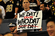 "A New Orleans Saints fan from the Who Dat Nation holds up a sign signifying the Who dat Nation owns ""Who Dat"" .New Orlenas Sainst (k) kicker Garrett Hartley (5) kicks a field  goal to tie the game and seend it to OT against the Atlanta Falcons, then misses a field goal in OT and teh Falcons went on to win 27-24.The Super Bowl Champions New Orleans Saints play the Atlanta Falcons Sunday Sept 26, 2010 in New Orleans at the Super Dome in Louisiana.  The Saints and Falcons are tied at half time and went into overtime tied 24-24. Hartley missed a kick to win in overtime., the Atlanta Falcons went on to win on OT with a field goal 27-24. PHOTO©SuziAltman.com"