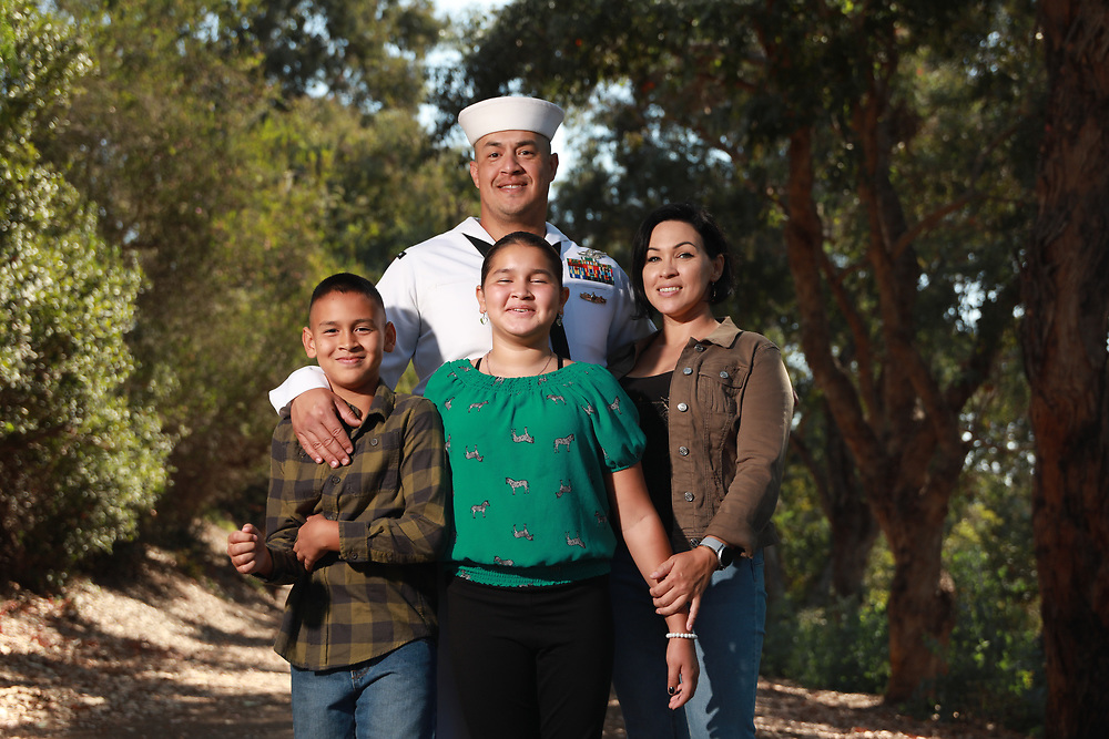 Juan Garcia, a Navy Hospital Corpsman, stands with his Wife and kids outside of their home in Chula Vista, CA on Saturday, September 18, 2021.(Photo by Sandy Huffaker/Getty Images for Scholastic Magazine)