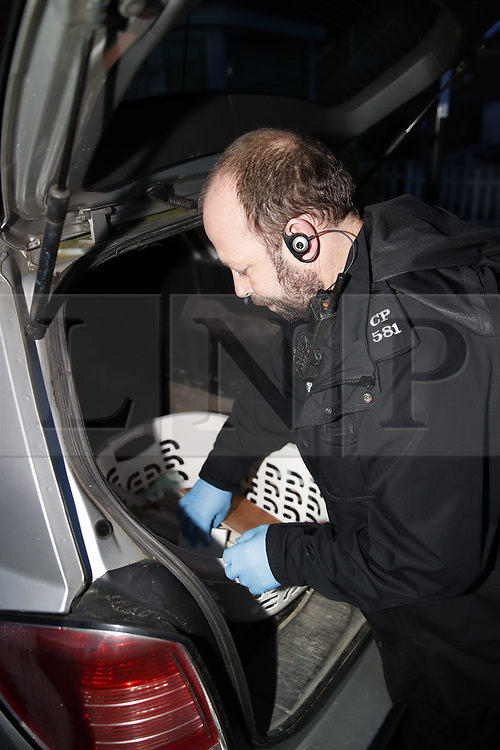 © Licensed to London News Pictures. 22/12/2018. Crawley, UK. Police search a car parked outside a property in Crawley. Is is not clear if this is in connection with the couple detained by police over the Gatwick drone attacks. Photo credit: Peter Macdiarmid/LNP