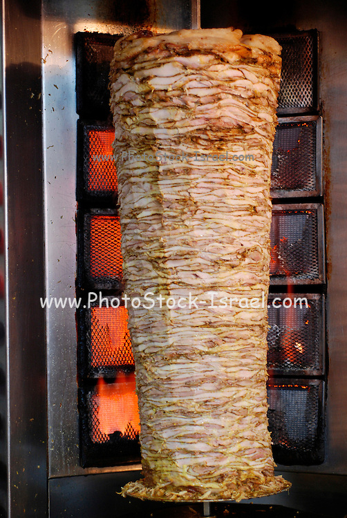 Shawarma a large skewer of lamb, chicken, turkey or beef meat and llamb fat. is a very popular street food in Israel and the middle east