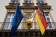 The European Union and German flags hang side-by-side outside the German Krakow General Consulate office, on 23rd September 2019, in Krakow, Malopolska, Poland.