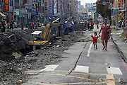 KAOHSIUNG, CHINA - AUGUST 04: (CHINA OUT) <br /> <br /> Gas Explosion Rips up entire road in china<br /> <br /> Excavators clear soil and stone pile after Kaohsiung\'s gas explosion on August 4, 2014 in Kaohsiung, Taiwam of China. Part of the pipeline was found wornout after 4 days of investigations. <br /> ©Exclusivepix