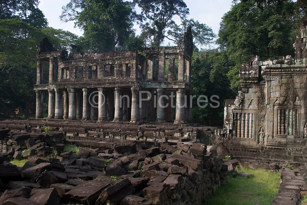 Preah Khan was built and used by Jayavarman VII. Living there while Angkor Thom was being reconstructed. Once having the role of monastery and university to many thousands, it then became an inter-denominational temple for Buddha, Shiva and Vishnu and the main deity Lokesvara (plus another 282 gods). Today it is in a state of semi-collapse, lichen and moss covered, and with the jungle trees encroaching it's walls.