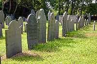 Gravestones stand in memorial at the Charter Street Burial Ground, historically known as Olde Burying Point, a colonial era cemetery, Salem Massachusetts, New England, North America, USA