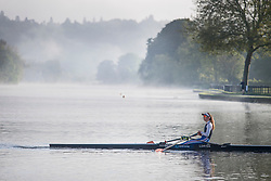© Licensed to London News Pictures. 24/05/2021. Henley-On-Thames, UK. A rower sits on the water surrounded by a mist covered landscape, in the early morning on the River Thames at Henley-on-Thames in Oxfordshire . Photo credit: Ben Cawthra/LNP