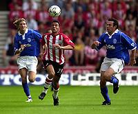 Photo: Richard Lane.<br />Southampton v Birmighma City. Barclaycard Premiership.<br />23/08/2003.<br />Fabrice Fernandes eyes the ball as Robbie Savage and Stan Lazaridis give chase.