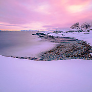 One morning when I was going to my work office at Geological Survey of Norway, I saw a fantastic sunrise close by my office. In fact my working place located close enough to Trondheim fjord . Anyway, I had my camera with me and couldn stop myself not to go and take some shots. I went down to the coast and I already impressed by the unusual winter strong colors. I put the camera on the tripod and went as close possible to the waves. I was little bit scared as well because I am not a good swimmer Anyway, I managed to get some very nice shots when I was standing still at least for 2-3 minutes.(Second picture)