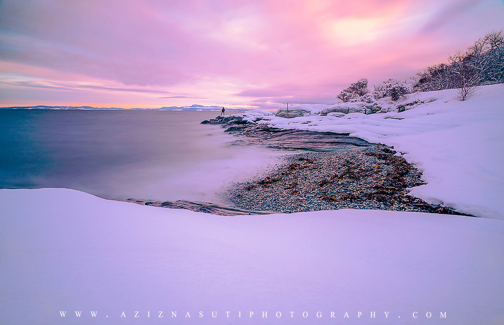 One morning when I was going to my work office at Geological Survey of Norway, I saw a fantastic sunrise close by my office. In fact my working place located close enough to Trondheim fjord . Anyway, I had my camera with me and couldn stop myself not to go and take some shots. I went down to the coast and I already impressed by the unusual winter strong colors. I put the camera on the tripod and went as close possible to the waves. I was little bit scared as well because I am not a good swimmer 