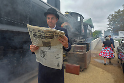 © Licensed to London News Pictures.09/09/2018. Goodwood. West Sussex, UK. <br /> The Goodwood motor circuit celebrates the 20th anniversary of the Revival.The Revival has become one of the biggest annual historic motorsport events in the world and the only one to be staged entirely in period dress. Each year over 150,000 people descend on this quiet corner of West Sussex to enjoy the three-day event.<br /> Pictured. Re-enactment group at Goodwood. <br /> Photo credit: Ian Whittaker/LNP