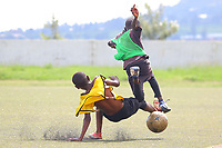 """U.K. soccer club Arsenal and the Rwandan Development Board announced a sponsorship deal in late May 2018 which will see """"Visit Rwanda"""" printed on the sleeves of the Arsenal kit for the next 3 seasons at a cost to the Rwanda Development board of £10million per season. It is  intended to promote tourism to Rwanda.Here young Rwanda boys play football in Kigali"""
