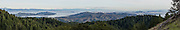 From atop Mount Tamalpais State Park along Panoramic Highway, in the Marin Headlands, see San Francisco skyscrapers, the Bay, Angel Island (dark green), and Berkeley in California, USA. The panorama was stitched from 7 overlapping images.