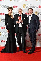 Sir David Attenborough with his BAFTA Award, alongside presenters Emma Willis and Dermot O'Leary at the Virgin TV British Academy Television Awards 2018 held at the Royal Festival Hall, Southbank Centre, London.