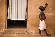 A boy stands by a doorway in Tano Akakro, Cote d'Ivoire on Saturday June 20, 2009.