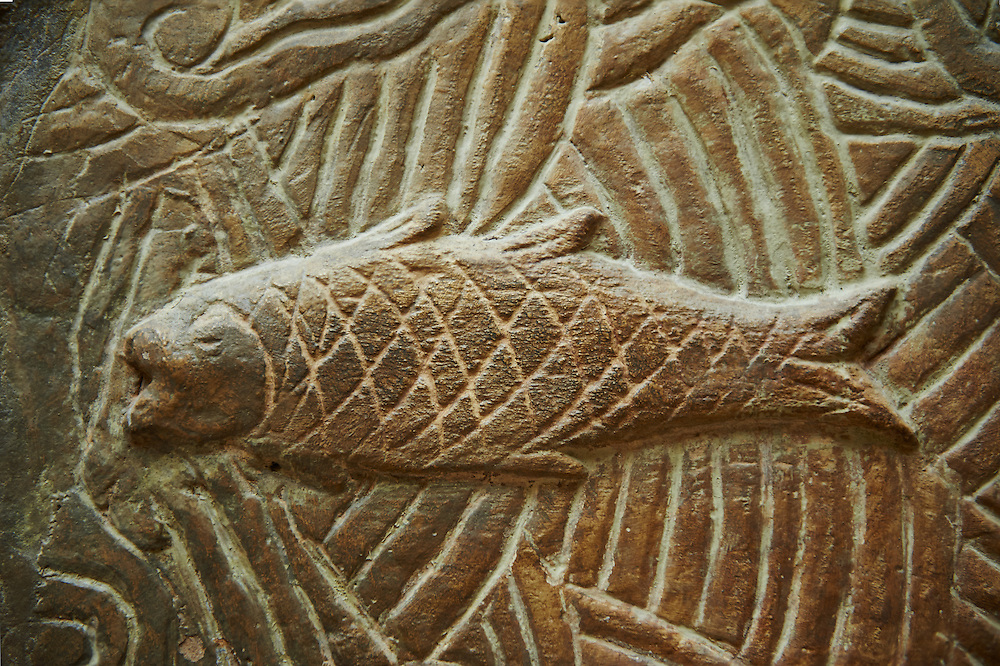 Stone relief sculptured panel of a fish. From the northern courtyard,  Inv AO 19890 from Dur Sharrukin the palace of Assyrian king Sargon II at Khorsabad, 713-706 BC.  Louvre Museum Room 4 , Paris .<br /> <br /> If you prefer to buy from our ALAMY PHOTO LIBRARY  Collection visit : https://www.alamy.com/portfolio/paul-williams-funkystock/ancient-assyria-antiquities.html  Refine search by adding background colour, place, subject, museum etc into the LOWER SEARCH WITHIN GALLERY box to <br /> <br /> Visit our ANCIENT WORLD PHOTO COLLECTIONS for more photos to download or buy as wall art prints https://funkystock.photoshelter.com/gallery-collection/Ancient-World-Art-Antiquities-Historic-Sites-Pictures-Images-of/C00006u26yqSkDOM