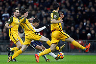 Erik Lamela of Tottenham Hotspur (c) takes a shot on goal whilst surrounded by Brighton defenders. Premier league match, Tottenham Hotspur v Brighton & Hove Albion at Wembley Stadium in London on Wednesday 13th December 2017.<br /> pic by Steffan Bowen, Andrew Orchard sports photography.